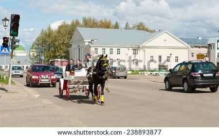 SUZDAL, RUSSIA - MAY 01, 2014: Road traffic at the center of the city