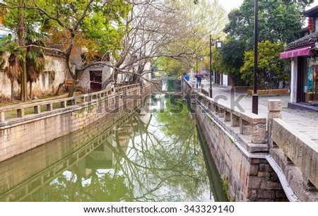 SUZHON, JIANGSU/CHINA-APR 12: Suzhou old town canals and folk houses on Apr 12,2015 in Suzhou, Jiangsu, China. Suzhou is one of the old watertowns in China. It is a famous tourist destination.