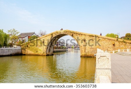 SUZHON, JIANGSU/CHINA-APR 12: Suzhou old town canals and stone bridge on Apr 11,2015 in Suzhou, Jiangsu, China. Suzhou is one of the old watertowns in China. It is a famous tourist destination.