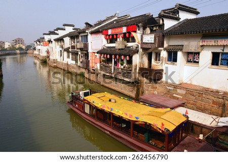 SUZHOU, CHINA - NOV 16, 2014: The ancient water town of Suzhou, China in Jiangsu province. It was founded in 514 B.C. and has been called the Venice of the East. - stock photo