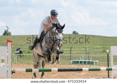 "SVEBOHOV, CZECH REPUBLIC - AUG 20: Closeup front view of horseman jumping a roan horse  at ""HobbyJumping Event  2016"" on August 20, 2016  in Svebohov, Czech Republic."