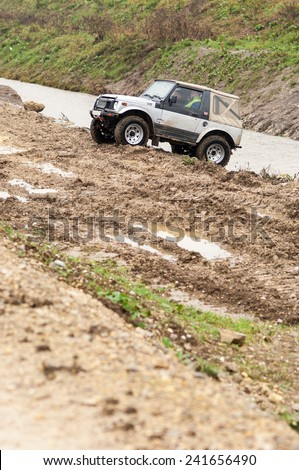 Sveta Nedelja, Croatia - October 30, 2014: 5th Rally Show Santa Domenica. An off-road car leaves steep slope. - stock photo