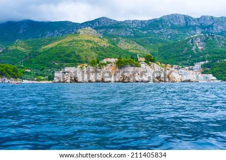 Sveti Stefan is a small islet and hotel resort in Montenegro, located next to the Budva. - stock photo
