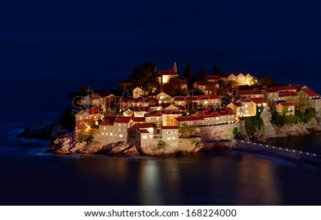 Sveti Stefan resort island in Montenegro at night - stock photo