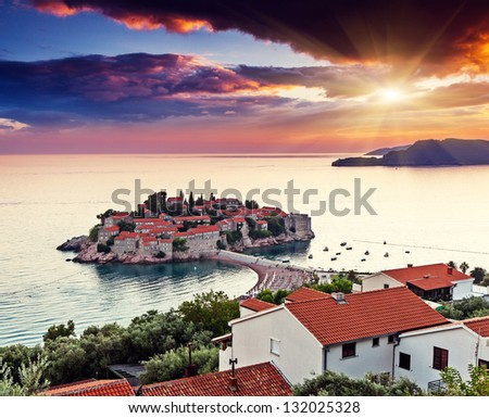 Sveti Stefan, small islet and resort in Montenegro. Overcast sky. Balkans, Adriatic sea, Europe. Beauty world - stock photo