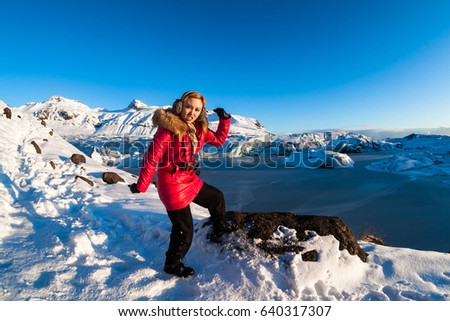 Svinafellsjokull glacier view during winter snow in Iceland with female model