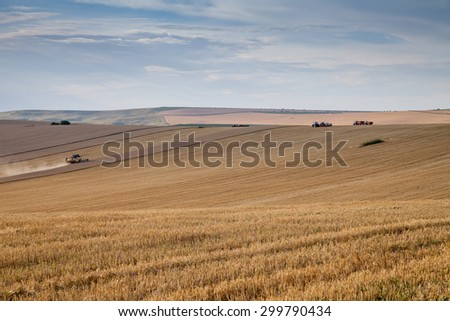 Svishtov - July 3: Agricultural landscape - agricultural machinery harvesting wheat pleated terrain of 3 July 2015, Svishtov, Bulgaria