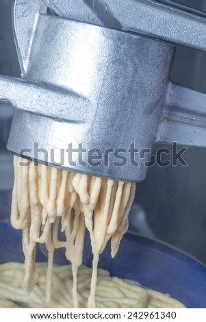 Swabian noodle machine for spaetzle - stock photo