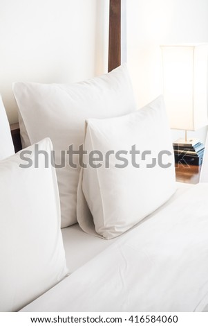 Swan towel decoration on bed with white pillow in bedroom interior