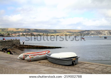 SWANAGE, DORSET, UK. OCTOBER 03, 2014.  A view across the bay with boats and slipway at Swanage, Dorset, UK. - stock photo