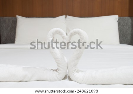 swans made from towels on the bed.valentine,valentine concept - stock photo