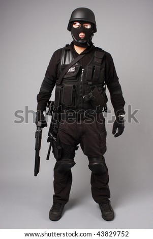 SWAT police officer with shotgun.