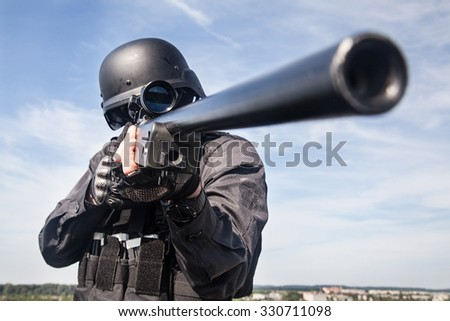 SWAT police sniper in black uniform in action - stock photo