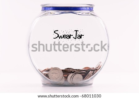 Swear Jar with Accumulated Coins - stock photo