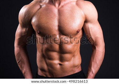 sweat body of young sexy muscular man standing over grey background