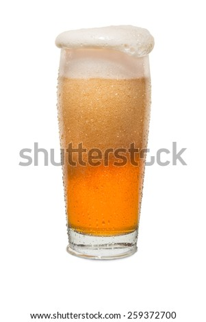 Sweated Craft Pub Beer Glass Overflowing with Beer #1 - stock photo