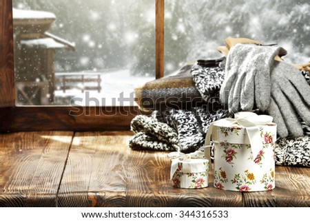 sweater and white boxes and wooden place