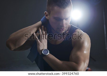 Sweaty man during training at the gym