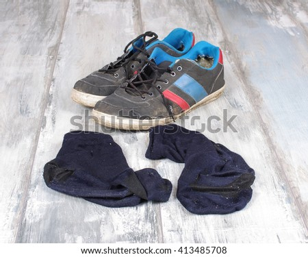 Sweaty socks and sneakers after hard workout - stock photo