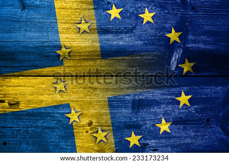 Sweden and European Union Flag painted on old wood plank texture - stock photo