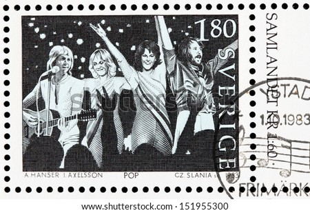 SWEDEN - CIRCA 1983: a stamp printed by Sweden shows image of famous Swedish musicians from ABBA band, circa 1983. - stock photo