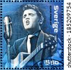 SWEDEN - CIRCA 2004: A stamp printed by SWEDEN shows image portrait of famous American singer Elvis Presley, circa 2004. - stock