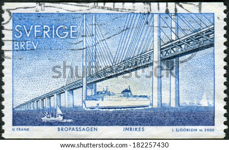 SWEDEN - CIRCA 2000: Postage stamp printed in Sweden, Completion of a fixed link between Denmark and Sweden across, shows the Oresund Bridge, circa 2000 - stock photo