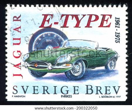 SWEDEN - CIRCA 1997: stamp printed by Sweden, shows E type Jaguar, circa 1997 - stock photo