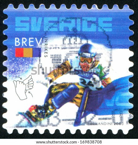 SWEDEN - CIRCA 2003: stamp printed by Sweden, shows Snowboarder and sign language, circa 2003 - stock photo
