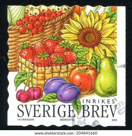 SWEDEN - CIRCA 2003: stamp printed by Sweden, shows Strawberries, sunflower, cherries, plums, apple, pear, circa 2003 - stock photo