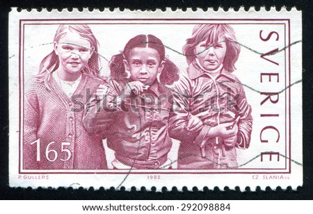 SWEDEN - CIRCA 1982: stamp printed by Sweden, shows three girls, circa 1982 - stock photo