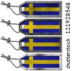 Sweden Flags Set of Grunge Metal Tags / Four grunge metallic tags with swedish flags, steel cable and metal rivets - stock photo