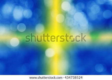 SWEDEN : National flag. Soft blurred bokeh natural background. Abstract gradient desktop wallpaper.  - stock photo