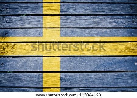sweden, swedish flag painted on old wood plank background - stock photo