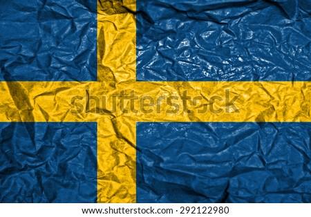 Sweden vintage flag on old crumpled paper background - stock photo