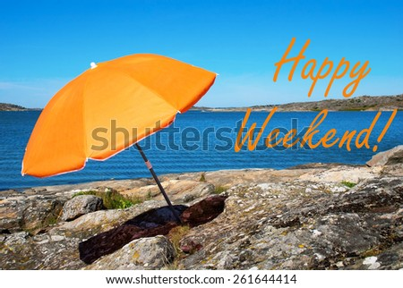 Swedish Coastline Bohuslan Archipelago h West Coast With Rocks And Cliffs And Beach With Orange Parasol And English Text Happy Weekend With Ocean And Open Sea Sunny Weather With Blue Sky - stock photo