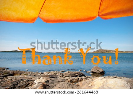 Swedish Coastline Bohuslan Archipelago Swedish West Coast With Rocks And Cliffs And Beach With Orange Parasol And English Text Thank You With Ocean And Sea Sunny Weather With Blue Sky - stock photo
