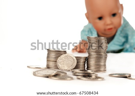 Swedish coins in the background a doll, isolated on white