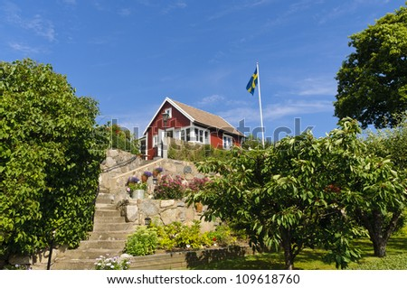 """Swedish cottages painted in the typical """"Falun red"""" color in Brandaholm, Karlskrona county, Sweden - stock photo"""