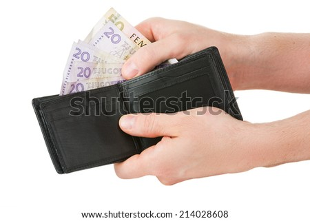 Swedish currency is taken out of black wallet - stock photo