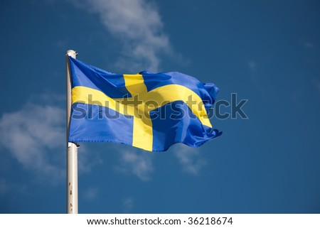 Swedish flag against blue sky - stock photo