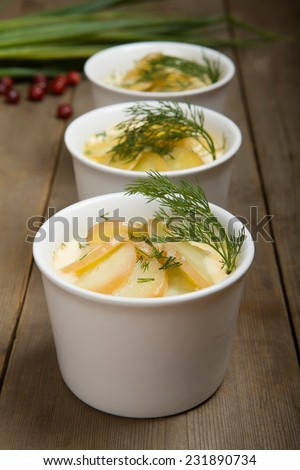 Swedish food: baked marinated salmon - gravadlux with potatoes and milk - stock photo