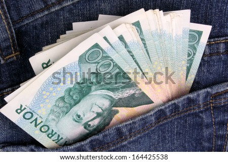 Swedish 100 Kroner notes in a jeans pocket.  - stock photo