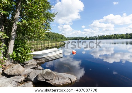 Swedish lake with boat in summer time