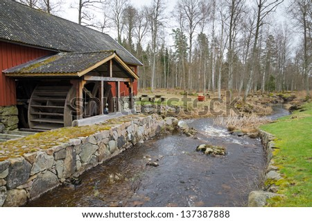 Swedish landscape with watermill - stock photo