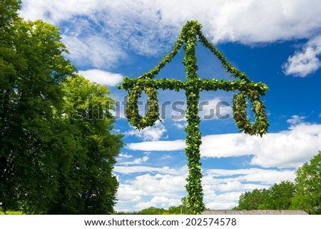 Swedish midsummer pole at blue sky - stock photo