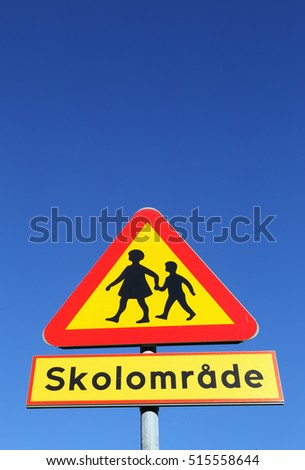 Swedish road sign beware of children with additional panel indicating a school area.