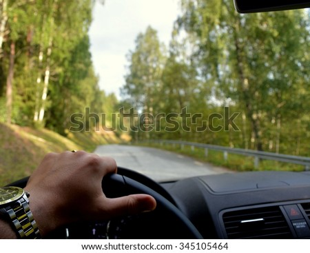 SWEDISH ROAD, SWEDEN - AUG 27, 2014: Driving on Swedish road through in the forest