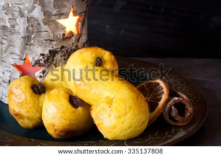 Swedish saffron buns, richly spiced and flavoured with saffron and cinnamon with currants. Traditionally served on St Lucia Day, December 13, also known as the Festival of Light in Sweden.