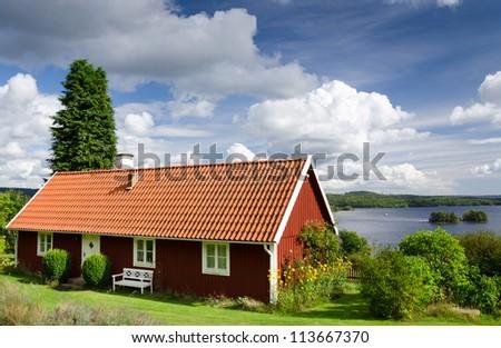 Swedish typical lake house near the lake - stock photo